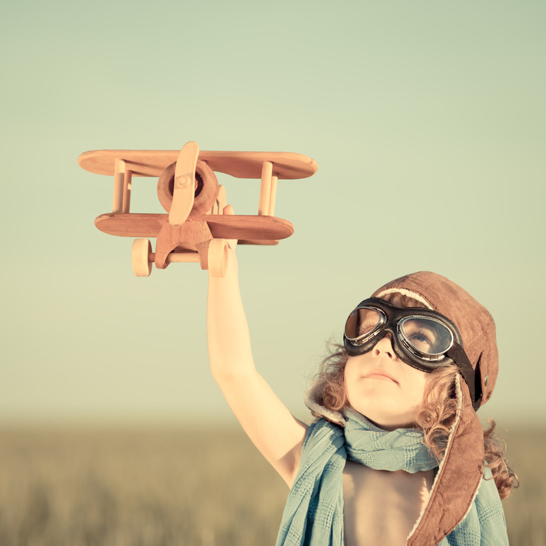 photodune-4789544-happy-kid-playing-with-toy-airplane-s